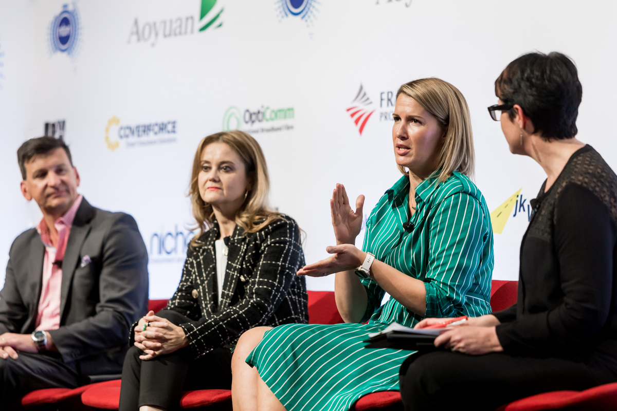 Corporate Event Photography - Woman speaking during a panel discussion