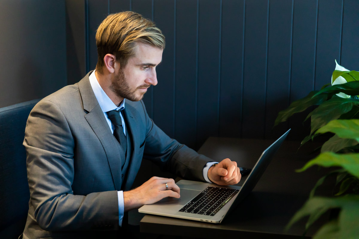 Corporate Lifestyle Photography - Man working on a laptop in a booth