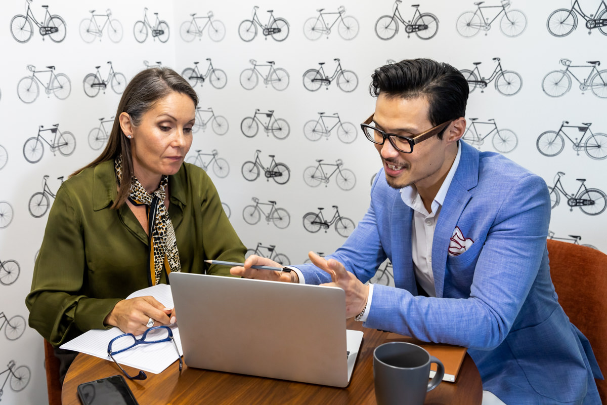 Corporate Lifestyle Photography - Two people conducting a meeting